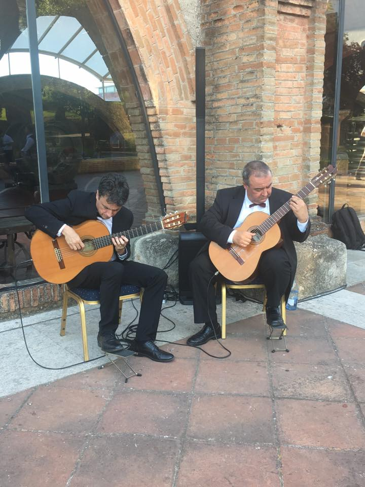 Guys playing guitars - mti events