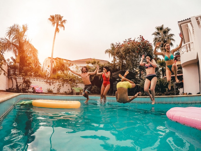 People-jumping-into-pool