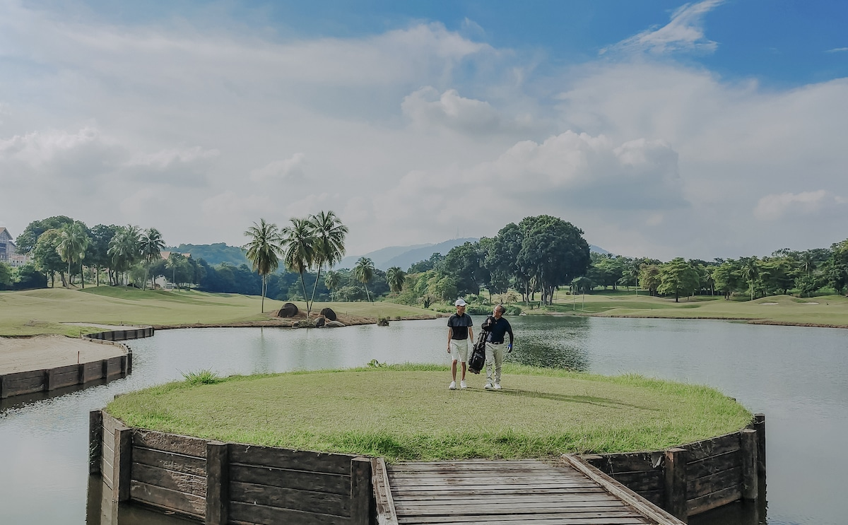Playing golf from island on course in malaysia